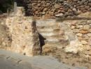 Santa Eularia - słupek z gliny z wyrytą  nazwą ulicy